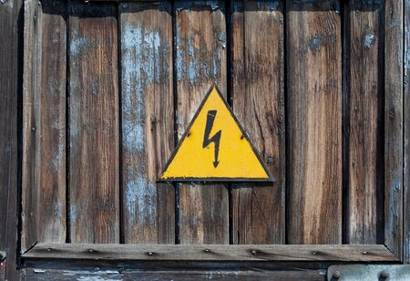 Old high voltage warning sign photo