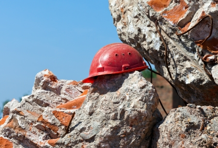 Old construction helmet over ruins photo