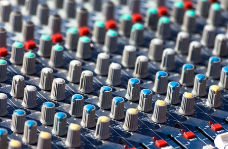 Part of an audio sound mixer with buttons photo