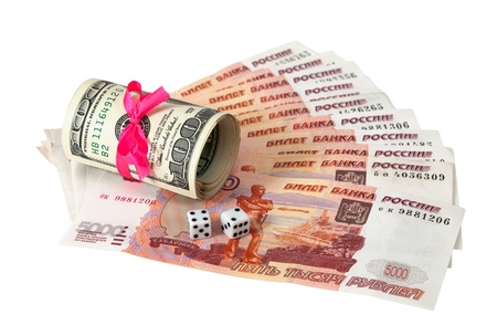 Two dice laying over a pile of money Stock Photo - 13925570