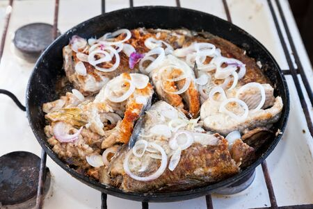Fried fish in a frying pan Stock Photo - 15327126