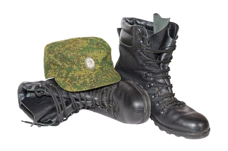 shoestring: Army boots and cap isolated on white