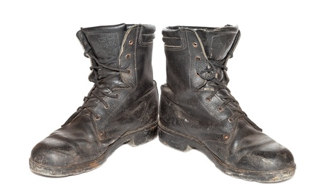 army boots: Old black army boots isolated on white