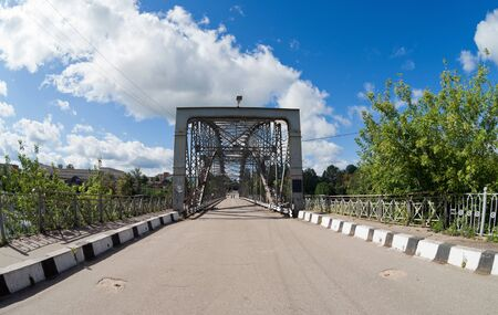 Old arched metal bridge in Novgorod region, Russia. Stock Photo - 15835803