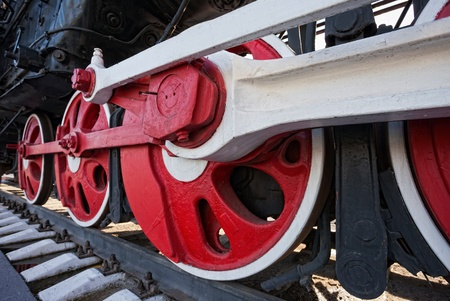 Old steam locomotive engine wheel and rods details photo