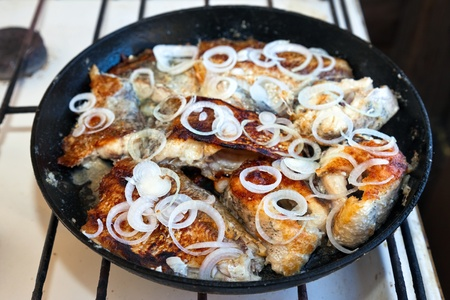 Fried fish in a frying pan Stock Photo - 16481176