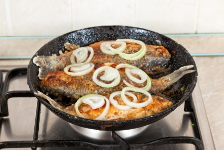 Fried fish in a frying pan Stock Photo - 16514054
