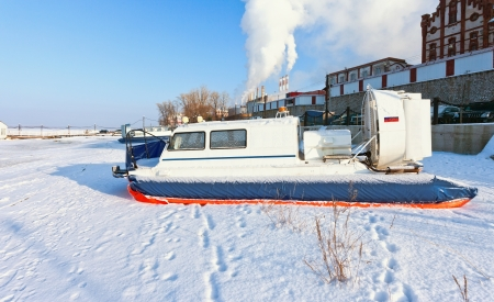 Hovercraft on the bank of a frozen river photo