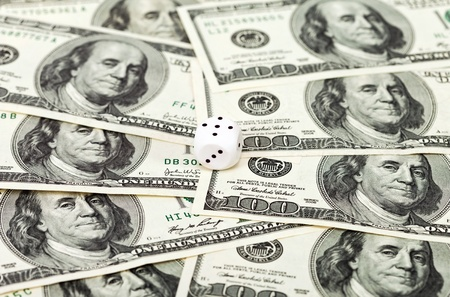 One dice on money background - business concept Stock Photo - 17433865