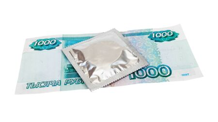 Condom with money on white background Stock Photo - 17570813