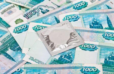 Condom on the russian rubles bills Stock Photo - 17570769