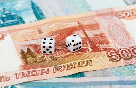 Two dice laying over a pile russian money Stock Photo - 17570808