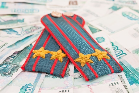 Shoulder strap of russian police on money background photo