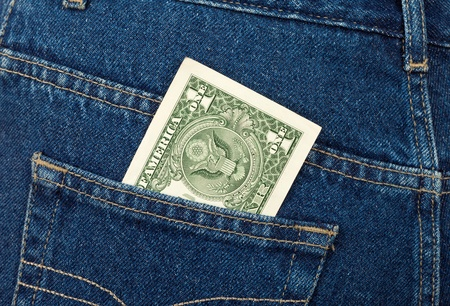 money in pocket: One U.S. dollar in the back jeans pocket