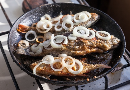 Fried fish in a frying pan Stock Photo - 21945499