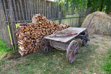 Old horse drawn wooden cart at the russian village in summer day photo