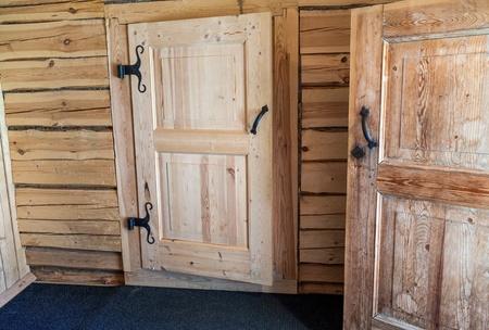 doorknocker: Wooden doors in russian house