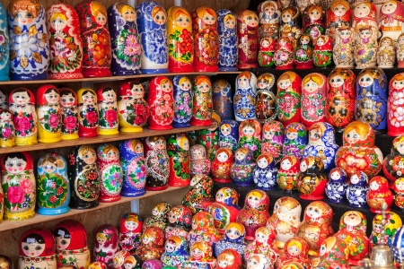 matryoshkas: NOVGOROD - AUGUST 10: Very large selection of matryoshkas Russian souvenirs at the gift shop on August 10, 2013 in Novgorod. Nesting dolls are the most popular souvenirs from Russia Editorial