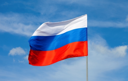 russian flag: Russian flag waving in the wind over blue sky
