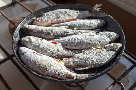 Fried fish in the old frying pan Stock Photo - 22257275