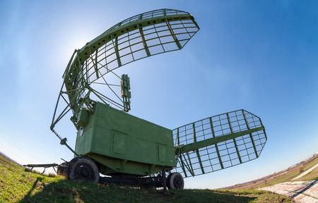Military russian radar station against blue sky photo