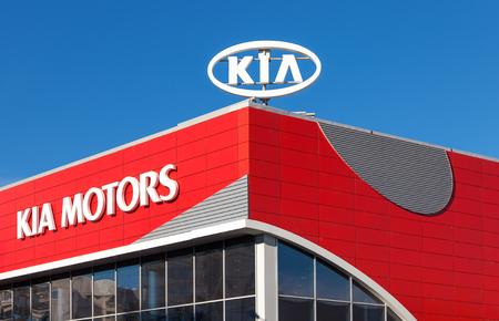 headquartered: SAMARA, RUSSIA - OCTOBER 20: The emblem KIA motors on blue sky background, October 20, 2013 in Samara, Russia. Kia Motors, headquartered in Seoul, is South Koreas second-largest automobile manufacturer Editorial