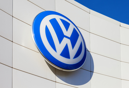 automaker: SAMARA, RUSSIA - OCTOBER 20: The emblem Volkswagen on blue sky background, October 20, 2013 in Samara, Russia. Volkswagen is the biggest German automaker and the third largest automaker in the world