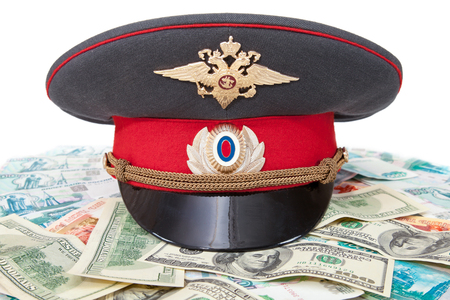 object oppression: Russian police officer cap on the batch of banknotes Stock Photo