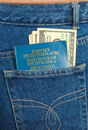 kyrgyz republic: Kyrgyz Republic passport and dollar bills in the back jeans pocket