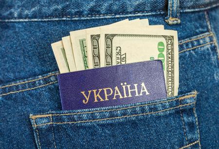 Ukraine passport and dollar bills in the back jeans pocket
