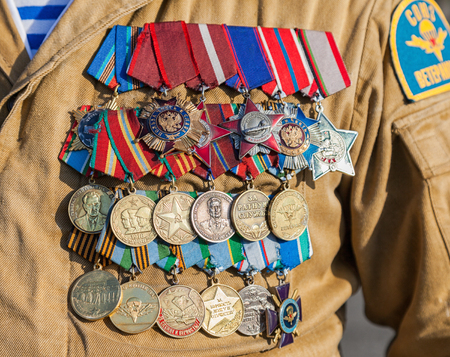 Different awards and medals on the russian military uniform
