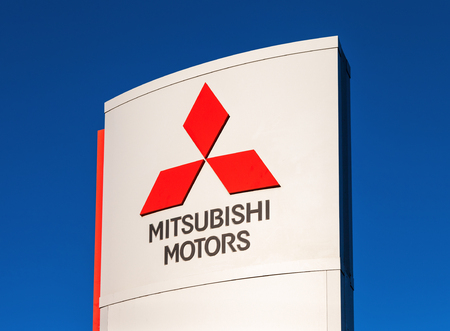 automaker: SAMARA, RUSSIA - NOVEMBER 24: The emblem Mitsubishi, November 24, 2013 in Samara, Russia. Mitsubishi Motors Corporation is a multinational automaker headquartered in Minato, Tokyo, Japan