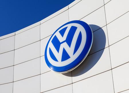 SAMARA, RUSSIA - NOVEMBER 23: The emblem Volkswagen on blue sky background, November 23, 2013 in Samara, Russia. Volkswagen is the biggest German automaker and the third largest automaker in the world