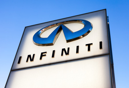 automaker: SAMARA, RUSSIA - NOVEMBER 23: The emblem INFINITI on blue sky background, November 23, 2013 in Samara, Russia. Infiniti is the luxury vehicle division of Japanese automaker Nissan Motor Company