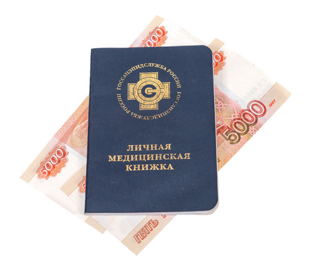 Russian medical book and money isolated on white Stock Photo