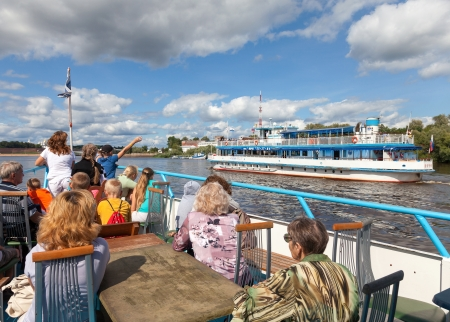 novgorod: NOVGOROD VELIKY, RUSSIA - AUGUST 10, 2013: Excursion ship on the Volhov river in Veliky Novgorod. Novgorod Veliky is Russian cultural heritage, was founded in 859