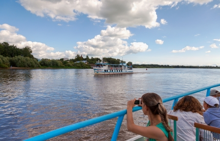 veliky: NOVGOROD VELIKY, RUSSIA - AUGUST 10, 2013: Excursion ship on the Volhov river in Veliky Novgorod. Novgorod Veliky is Russian cultural heritage, was founded in 859   Editorial