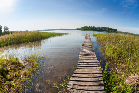 Summer landscape with lake and old wooden bridge Stock Photo