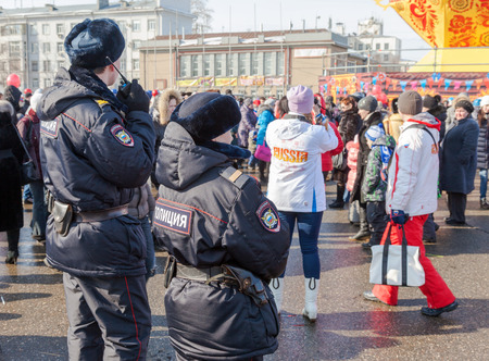 maslenitsa: RUSSIA, SAMARA - March 2, 2014: Police patrol at the Shrovetide celebration. Maslenitsa or Pancake Week is the Slavic Holiday that dates back to the pagan times. Editorial