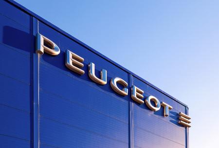 psa: SAMARA, RUSSIA - NOVEMBER 24, 2013: The emblem Peugeot on the building of official dealer. Peugeot is a French car brand, part of PSA Peugeot Citroen.