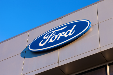 headquartered: SAMARA, RUSSIA - NOVEMBER 24, 2013: The emblem Ford on the office of official dealer. Ford Motor Company is an American multinational automaker headquartered in Dearborn, Michigan, US