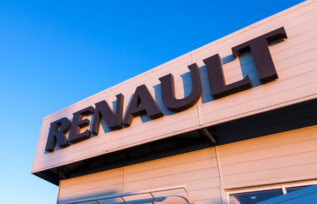 busines: SAMARA, RUSSIA - NOVEMBER 24, 2013: The emblem Renault on the office of official dealer. Renault is a French multinational vehicle manufacturer established in 1899 Editorial