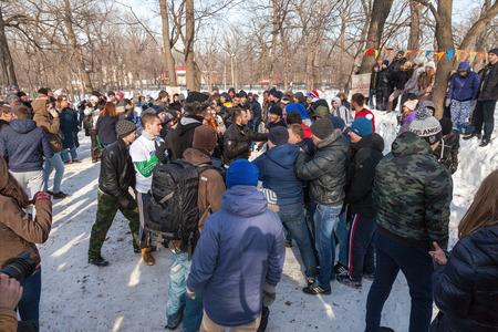maslenitsa: RUSSIA, SAMARA - March 2, 2014: Samara youth celebrates Shrovetide. Maslenitsa or Pancake Week is the only purely Slavic Holiday that dates back to the pagan times.