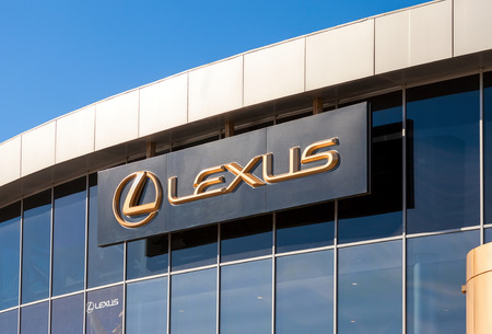 automaker: SAMARA, RUSSIA - OCTOBER 20: The emblem Lexus on blue sky background, October 20, 2013 in Samara, Russia. Lexus is the luxury vehicle division of Japanese automaker Toyota Motor Corporation