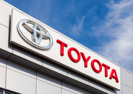 SAMARA, RUSSIA - APRIL 19, 2014: The emblem Toyota on the office of official dealer. Toyota Motor Corporation  is a Japanese automotive manufacturer headquartered in Toyota, Aichi, Japan Editorial