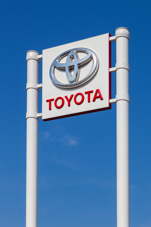 headquartered: SAMARA, RUSSIA - APRIL 19, 2014: The emblem Toyota on the office of official dealer. Toyota Motor Corporation is a Japanese automotive manufacturer headquartered in Toyota, Aichi, Japan