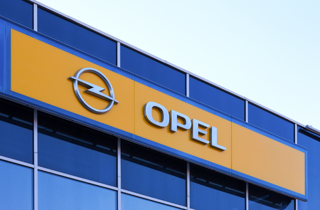SAMARA, RUSSIA - APRIL 19, 2014  The emblem of Opel over blue sky  Opel is a German automobile manufacturer headquartered in Russelsheim, Hesse, Germany and a subsidiary of the American General Motors Company