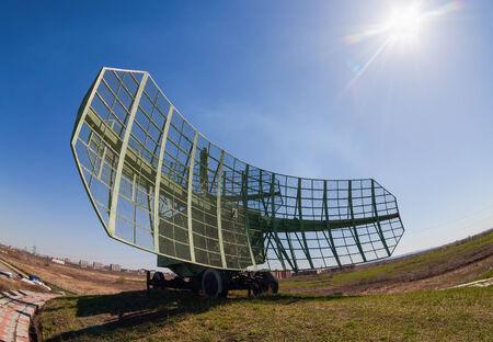 Military russian radar station against blue sky photo