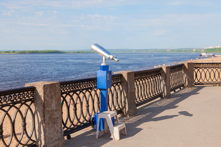 Coin operated binocular on the bank of river in summertime  photo