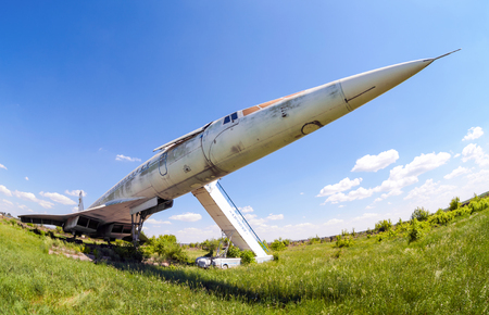 aerodrome: SAMARA, RUSSIA - MAY 25, 2014: Tupolev Tu-144 plane was the first in the world commercial supersonic transport aircraft at the abandoned aerodrome